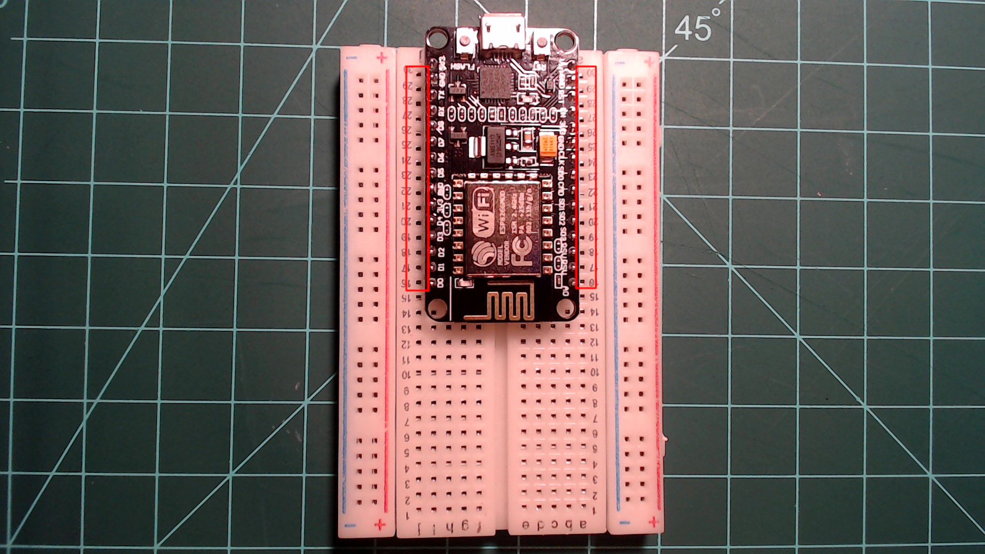 Center the NodeMCU in the breadboard as seen here.